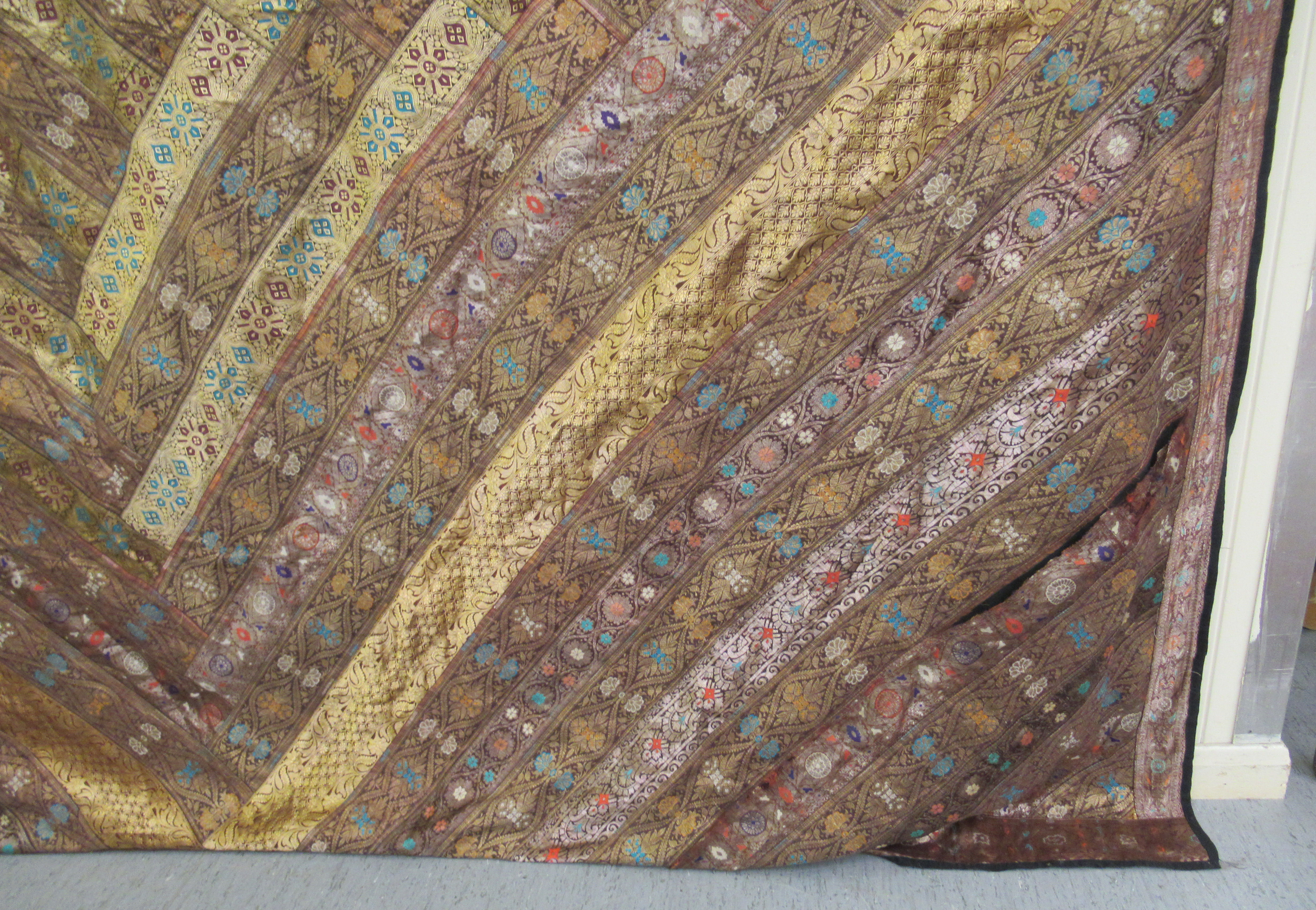 An Indian part silk bed throw, profusely decorated with repeating floral designs with a black fabric - Image 2 of 7