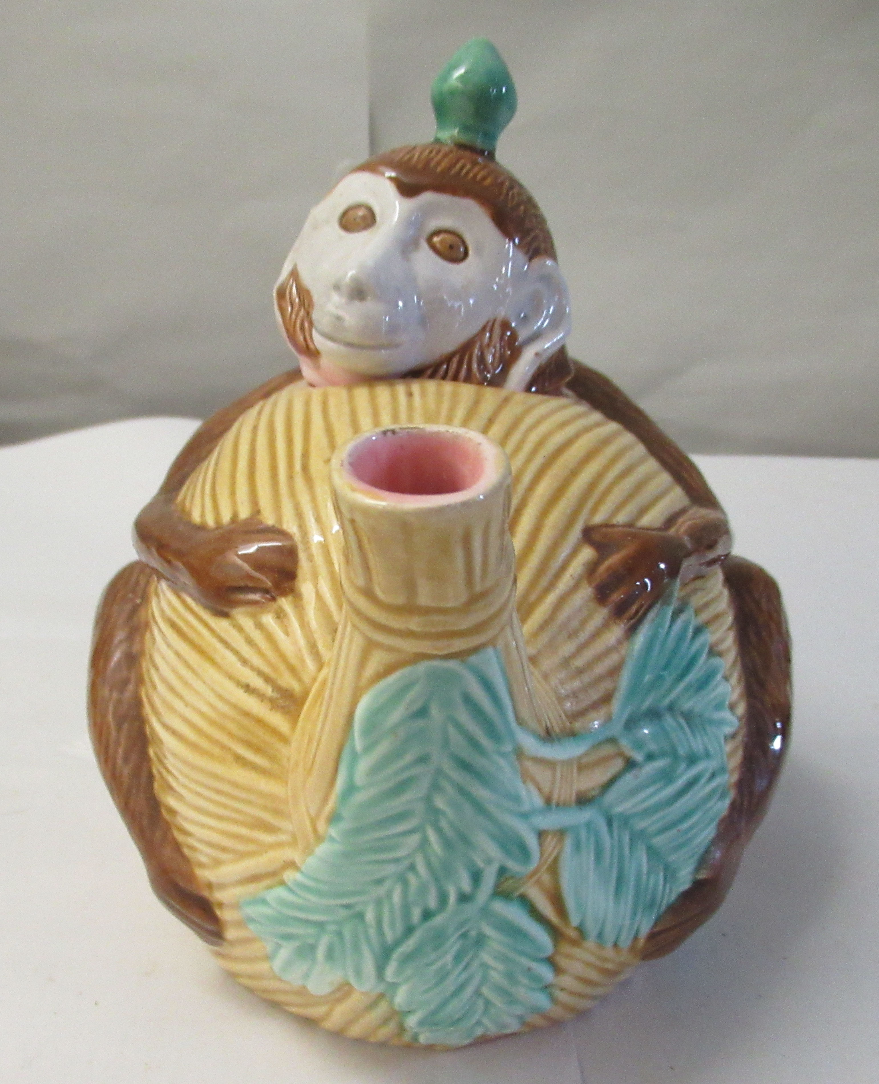 A 20thC reproduction of a Minton majolica teapot, fashioned as a monkey