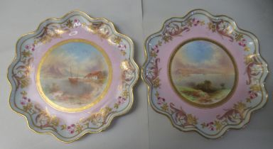 """A pair of late 19thC porcelain plates, each decorated with loch scenes 9""""dia"""