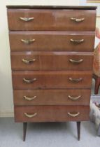 """A mid 20thC mahogany finished six drawer dressing chest, raised on tapered legs 45""""h 26""""w"""