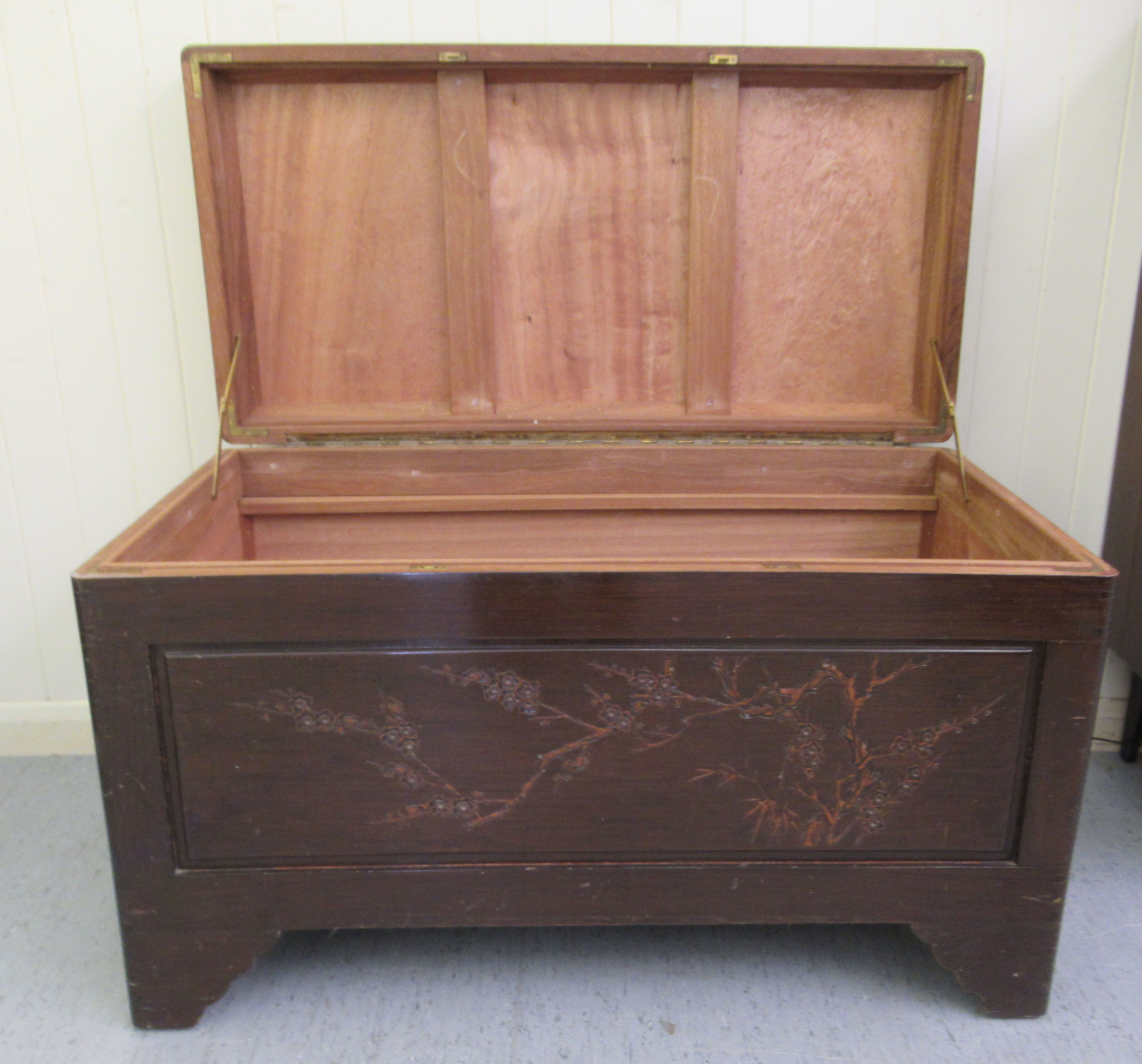 A mid 20thC Chinese carved camphorwood chest, having straight sides and a hinged lid, raised on - Image 2 of 6