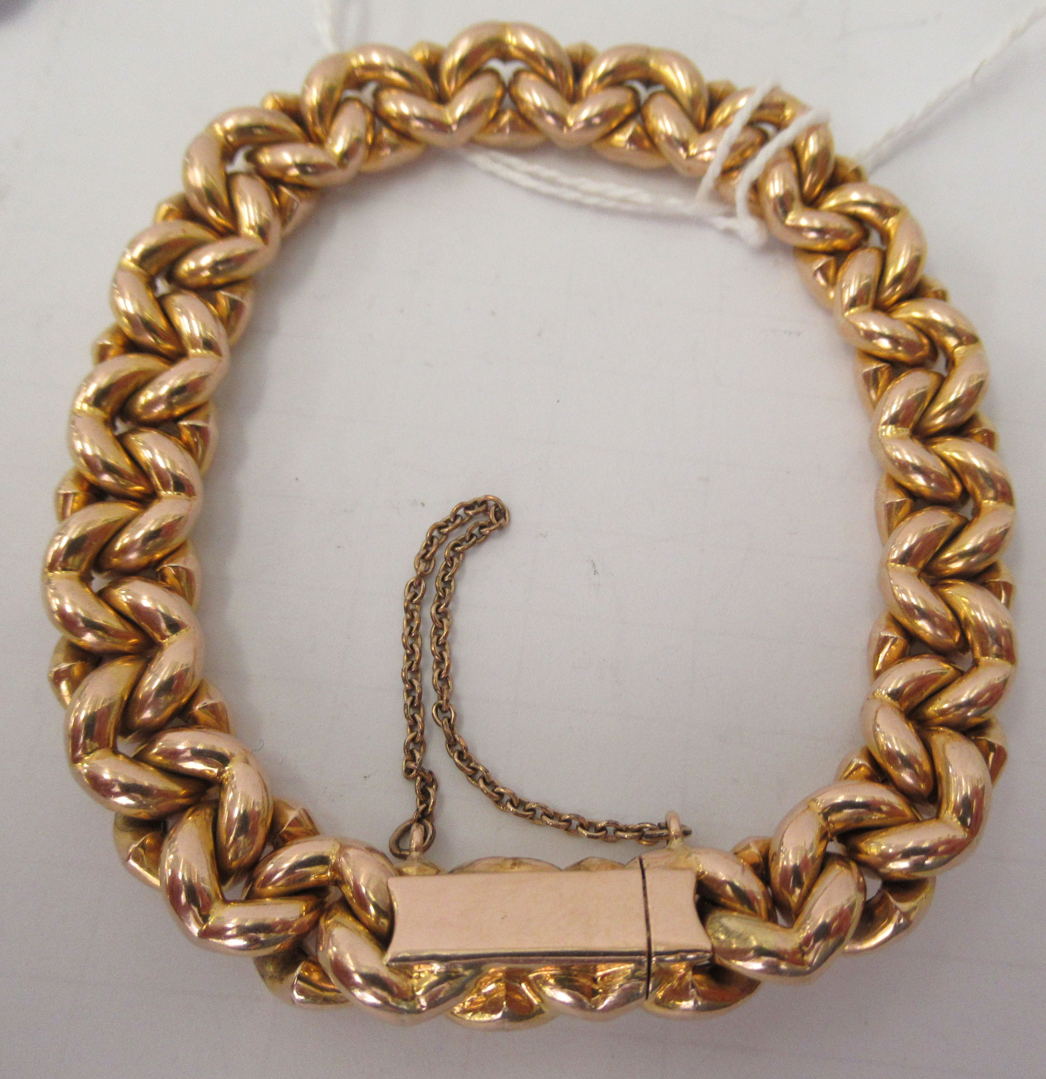 A 15ct gold fancy link bracelet, on a bayonet clasp and safety chain - Image 2 of 3