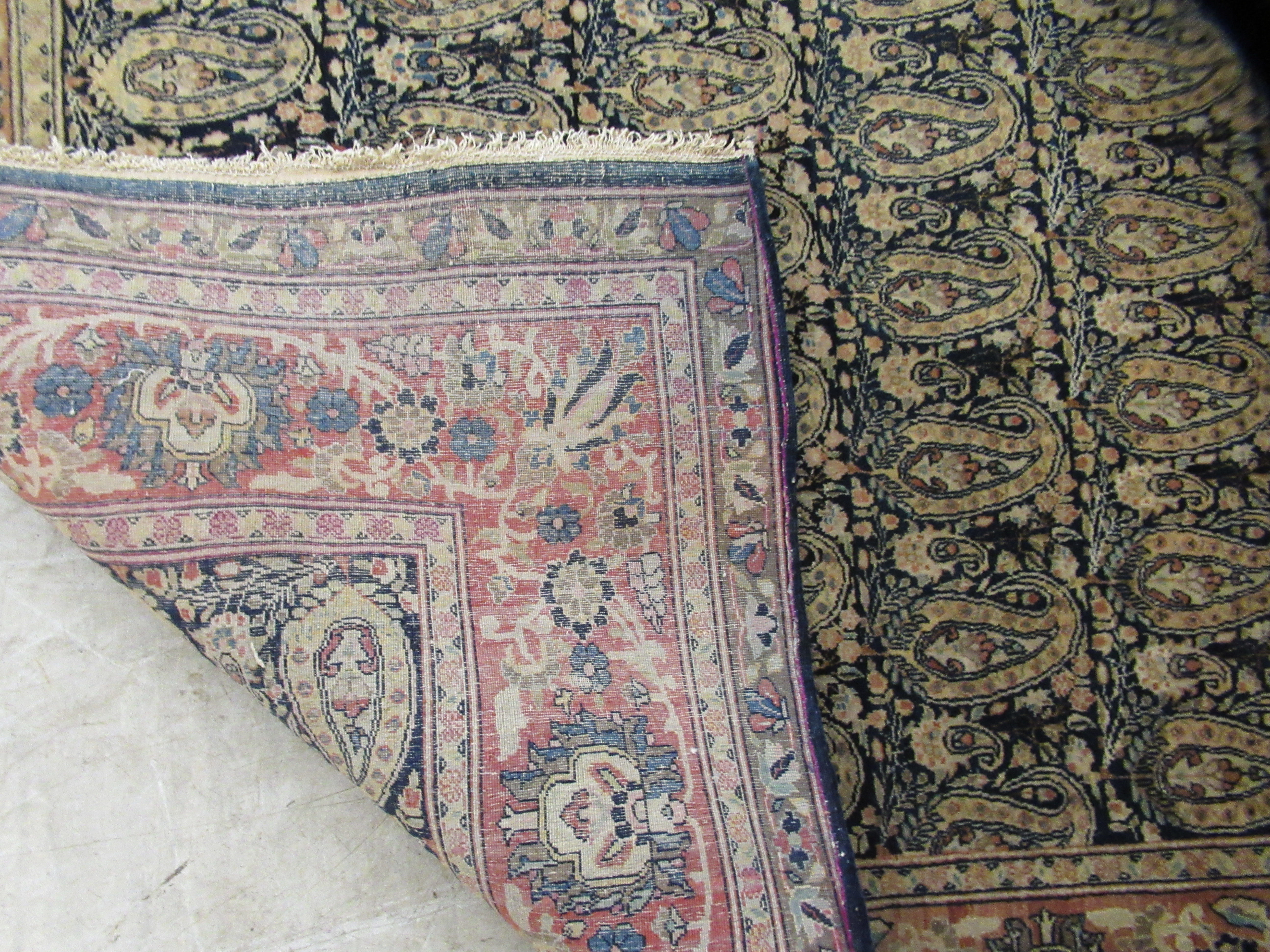 A Persian rug decorated with repeating stylised designs, bordered by floral and foliage, on a - Image 4 of 4