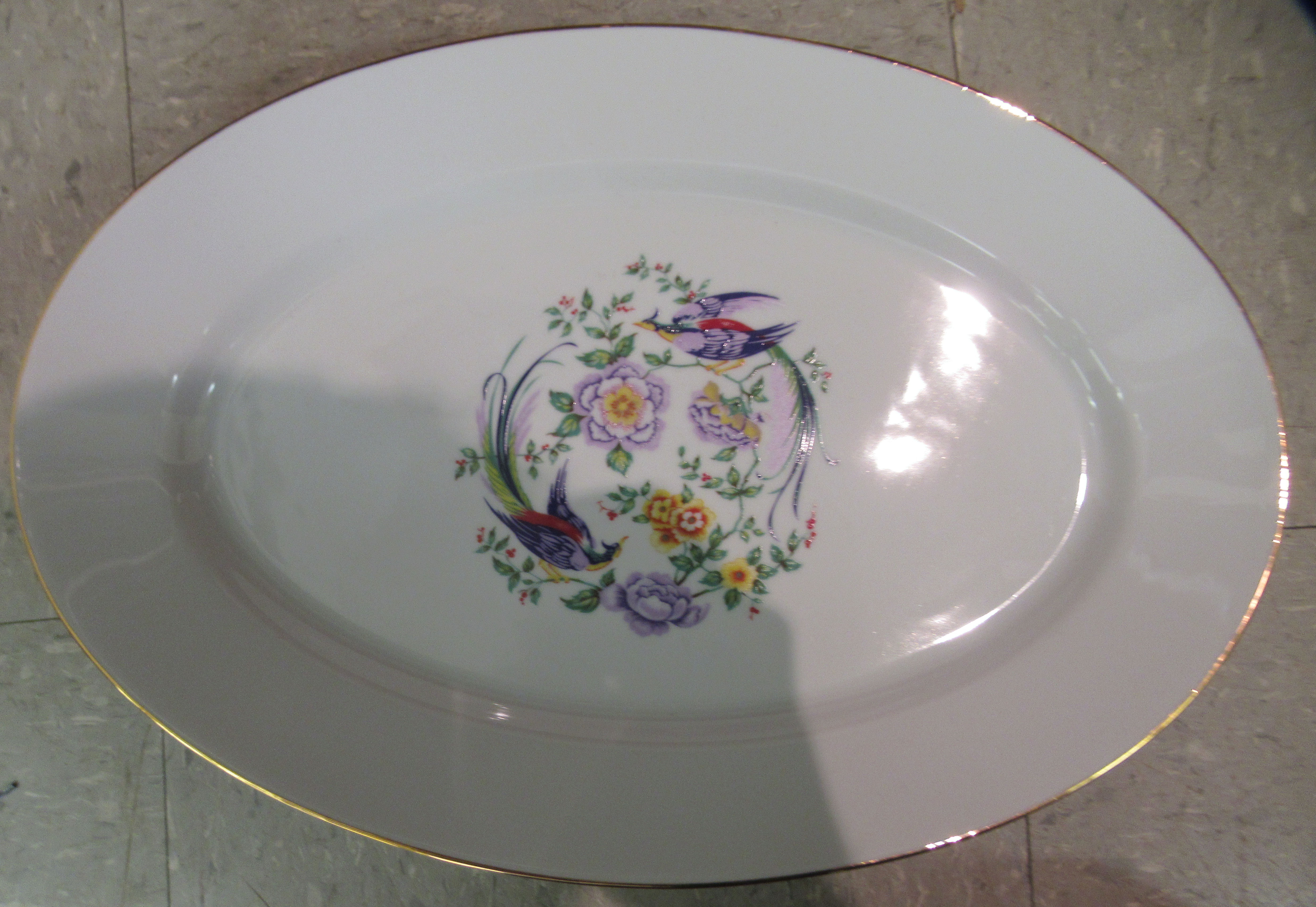 A Limoges porcelain dinner service, decorated with birds of paradise and flora - Image 6 of 7