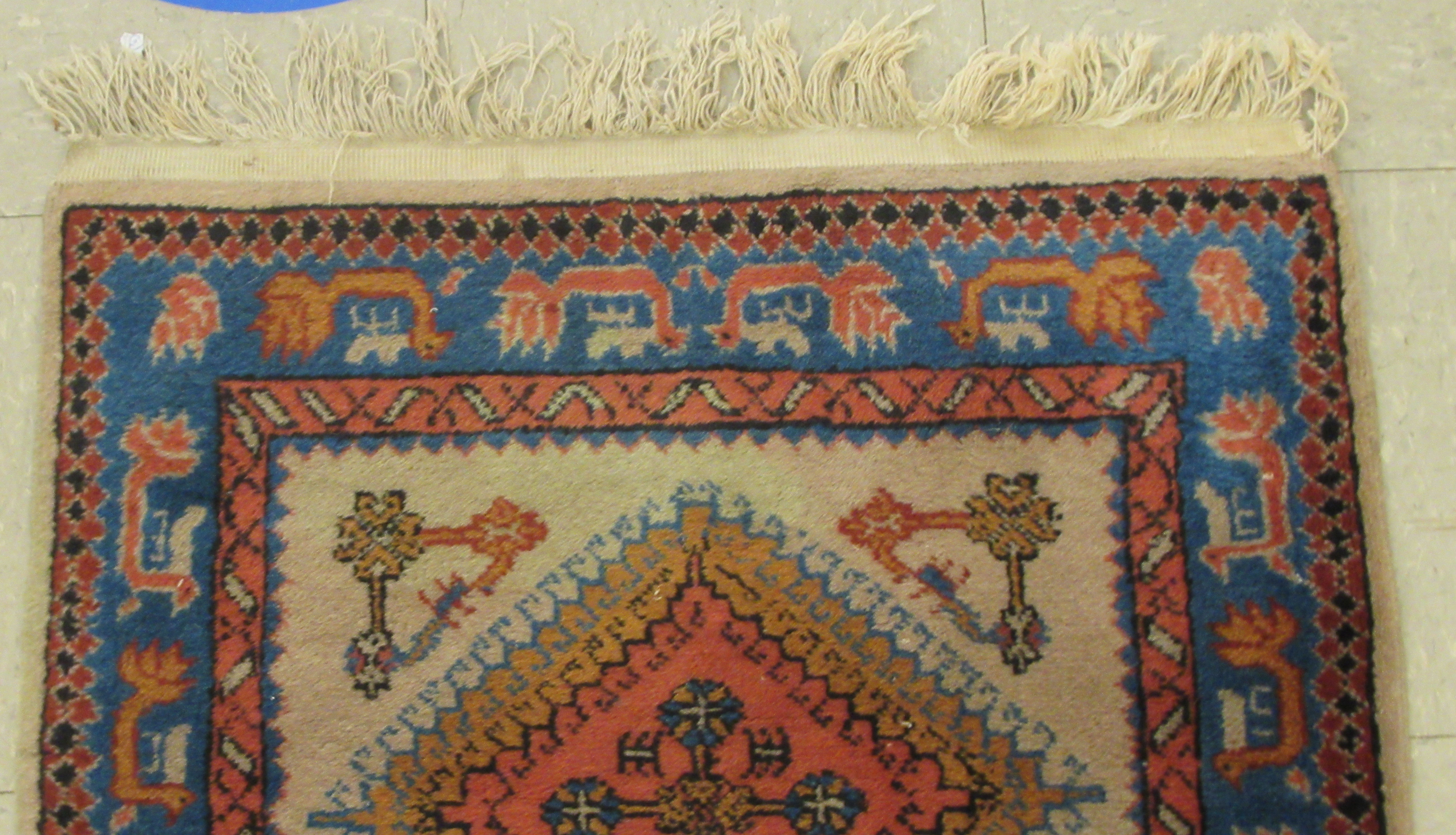 A Samarkand runner, decorated with repeating diamond formations, bordered by stylised designs, on - Image 4 of 5