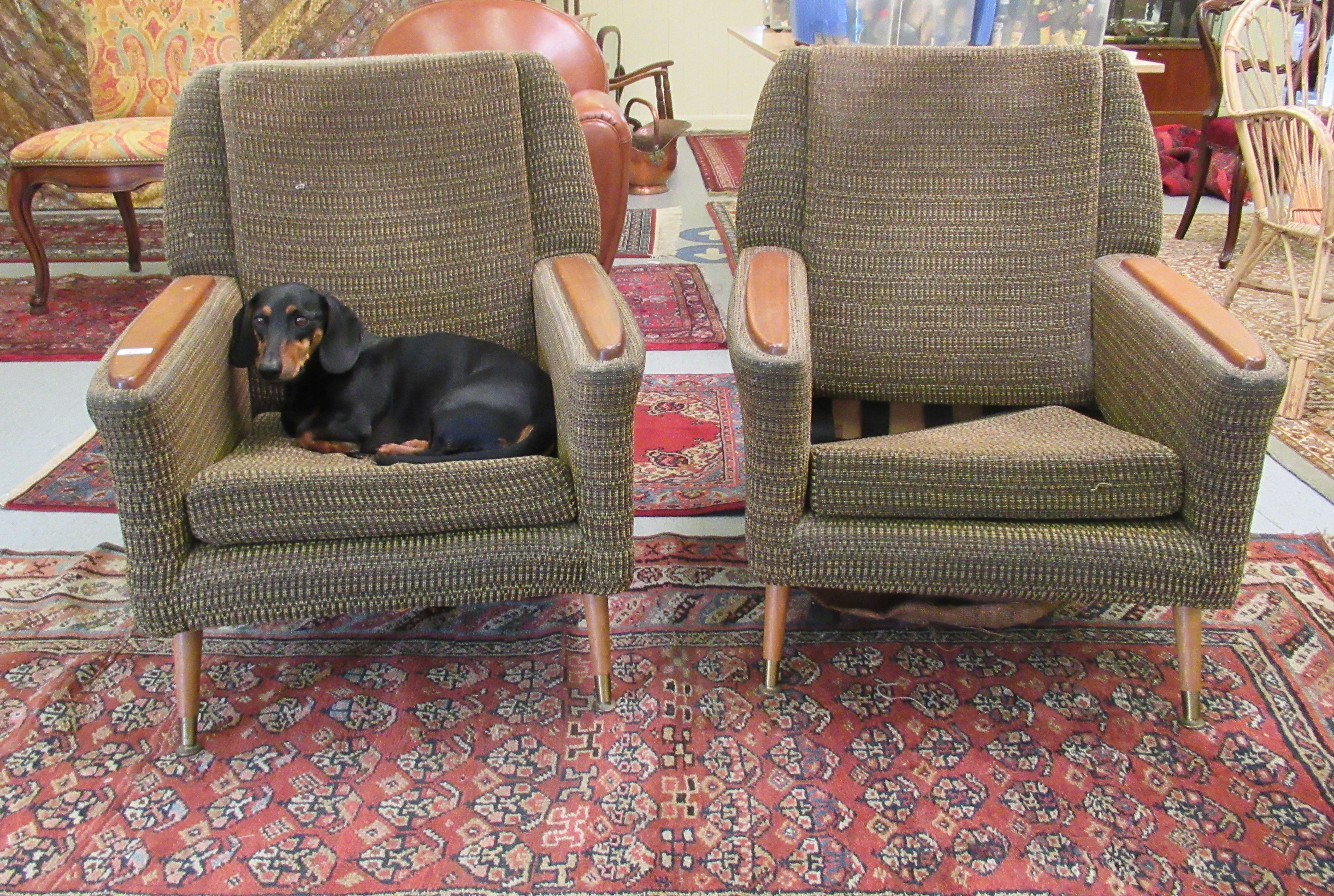 A pair of 1960s/1970s three tone, textured fabric upholstered, low, enclosed armchairs with panelled