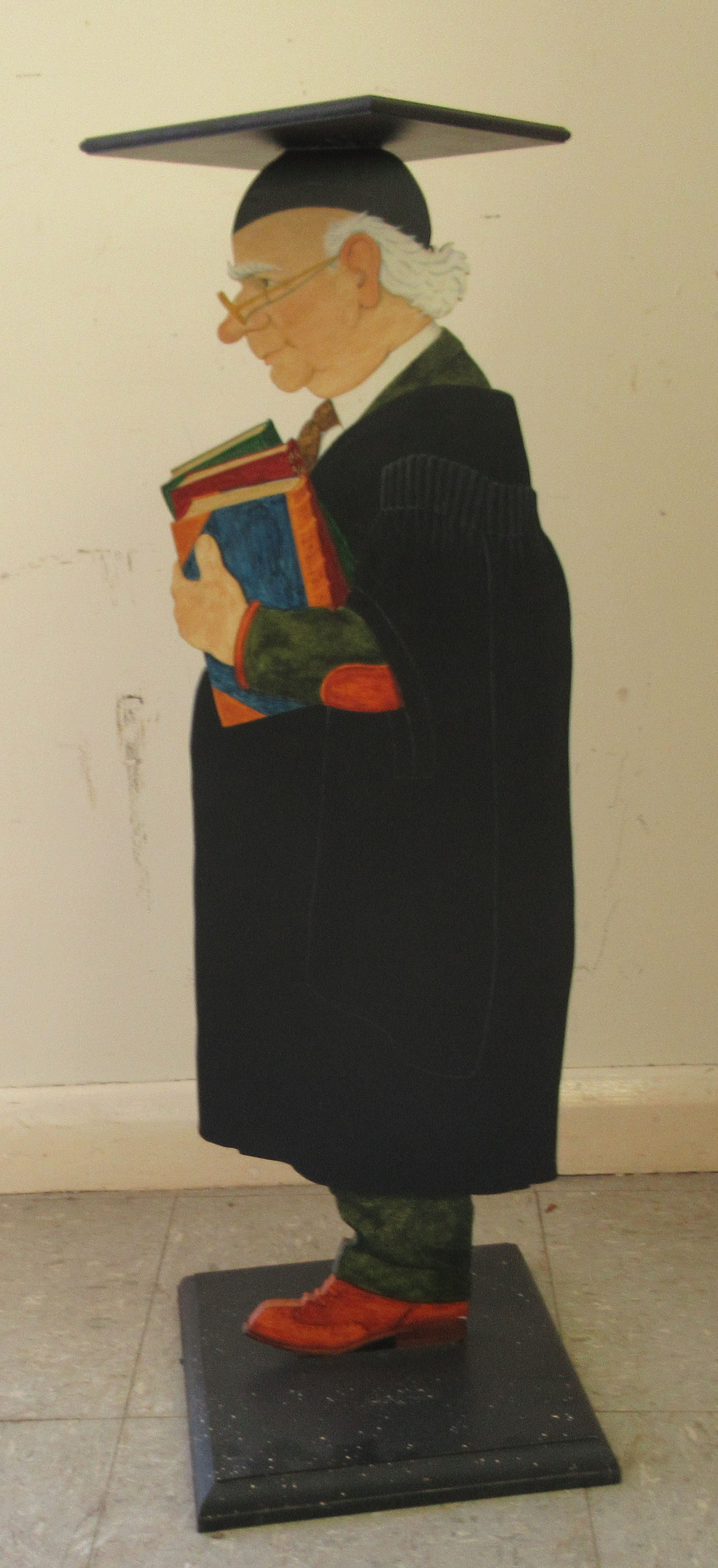 """A modern novelty waiter, fashioned as a headmaster, wearing a gown and mortarboard 32""""h"""