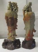 A matched pair of 20thC Chinese carved green and brown soapstone standing figures, each with a