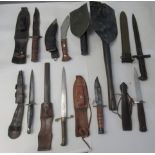 Military style and other daggers; and two trenching tools (Please Note: this lot is offered subject