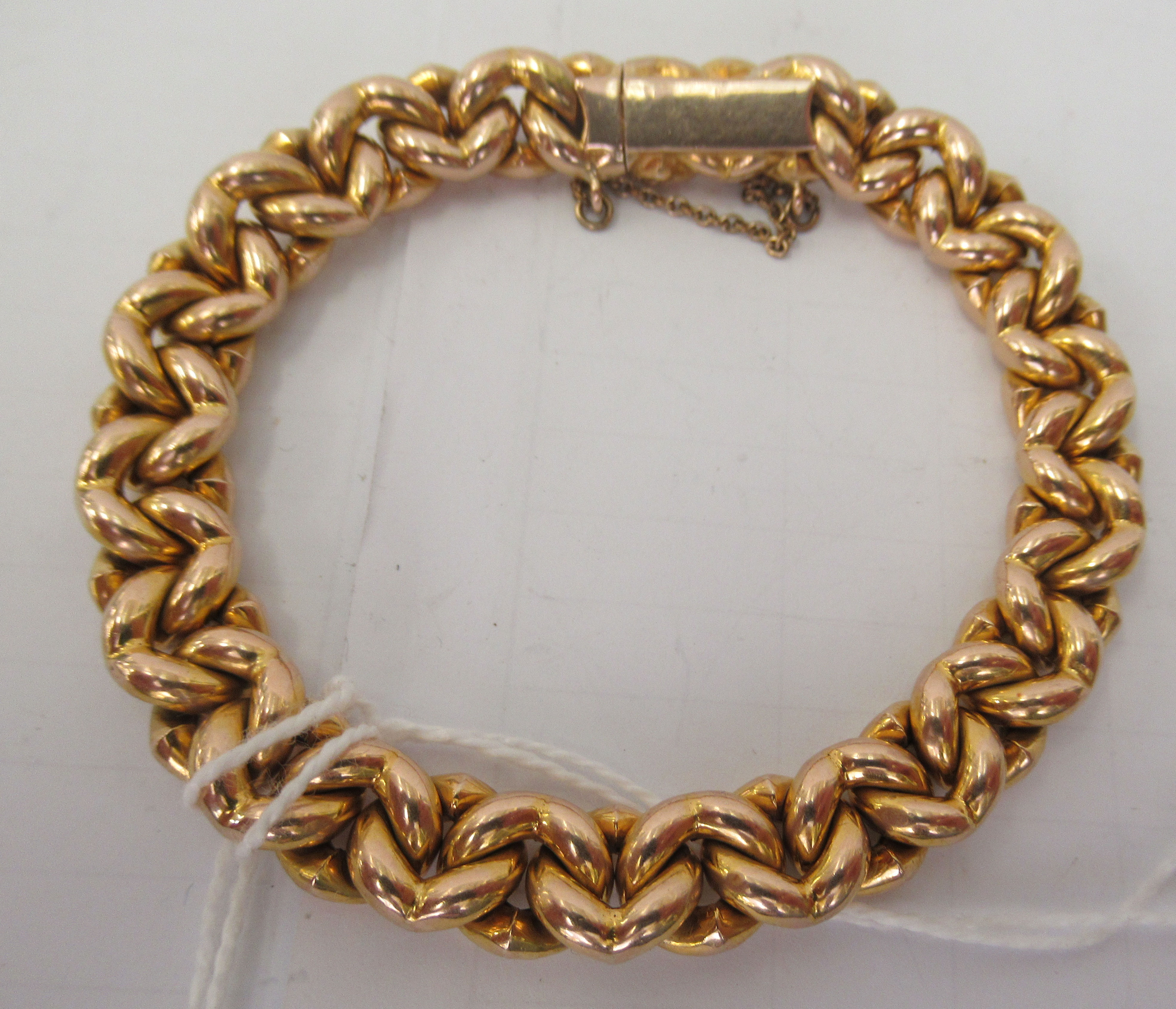 A 15ct gold fancy link bracelet, on a bayonet clasp and safety chain