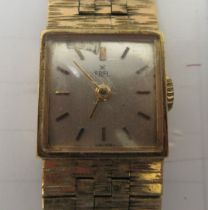 A lady's Ebel 9ct gold cased wristwatch, faced by a baton dial, on a 9ct gold flexible strap