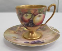 A Royal Worcester china matched pedestal coffee cup and saucer, decorated with soft fruit and