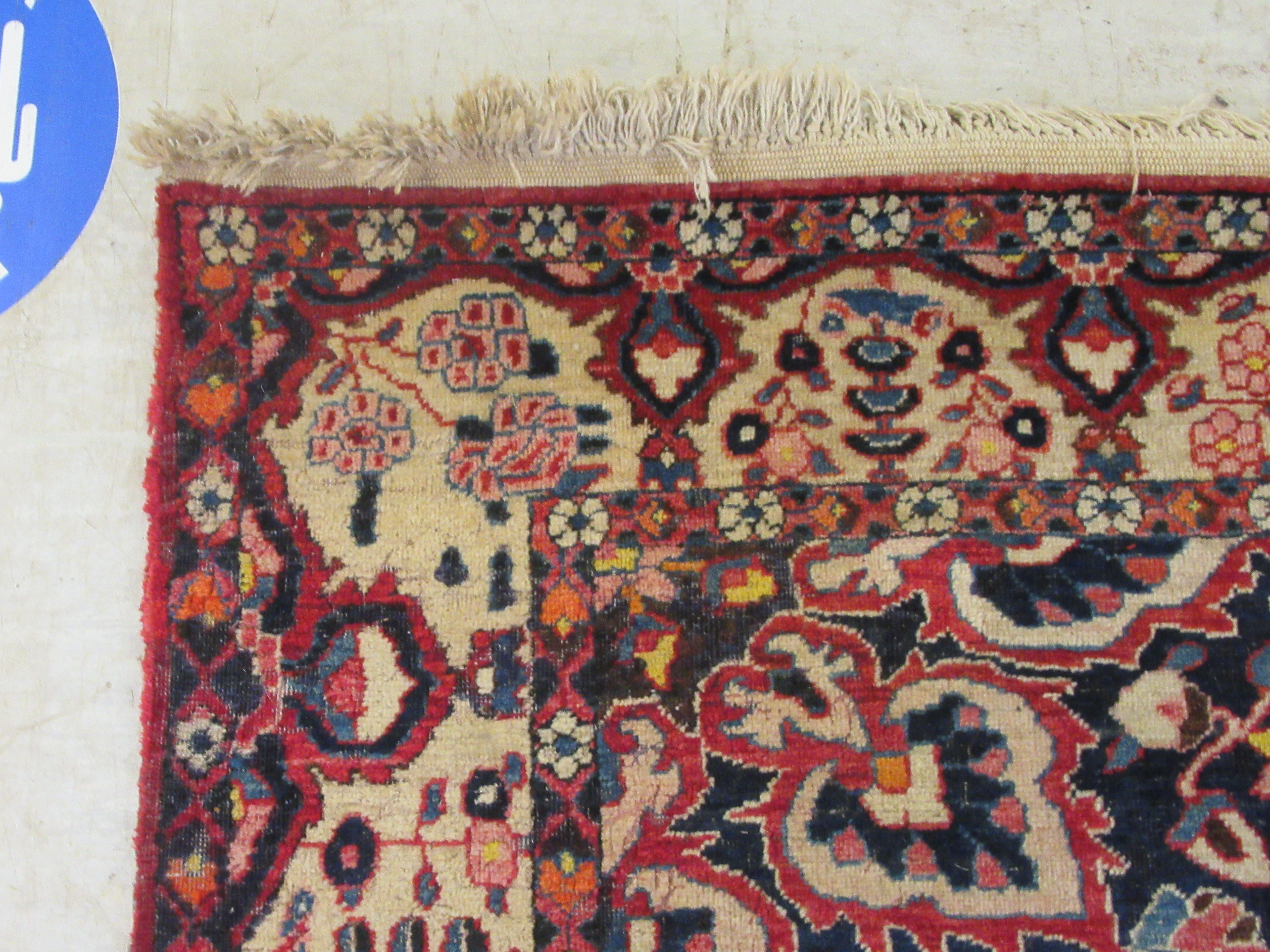 A Persian carpet, profusely decorated with flora and other designs, on a multi-coloured and red - Image 4 of 5