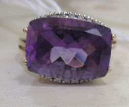 A 9ct gold amethyst and diamond ring