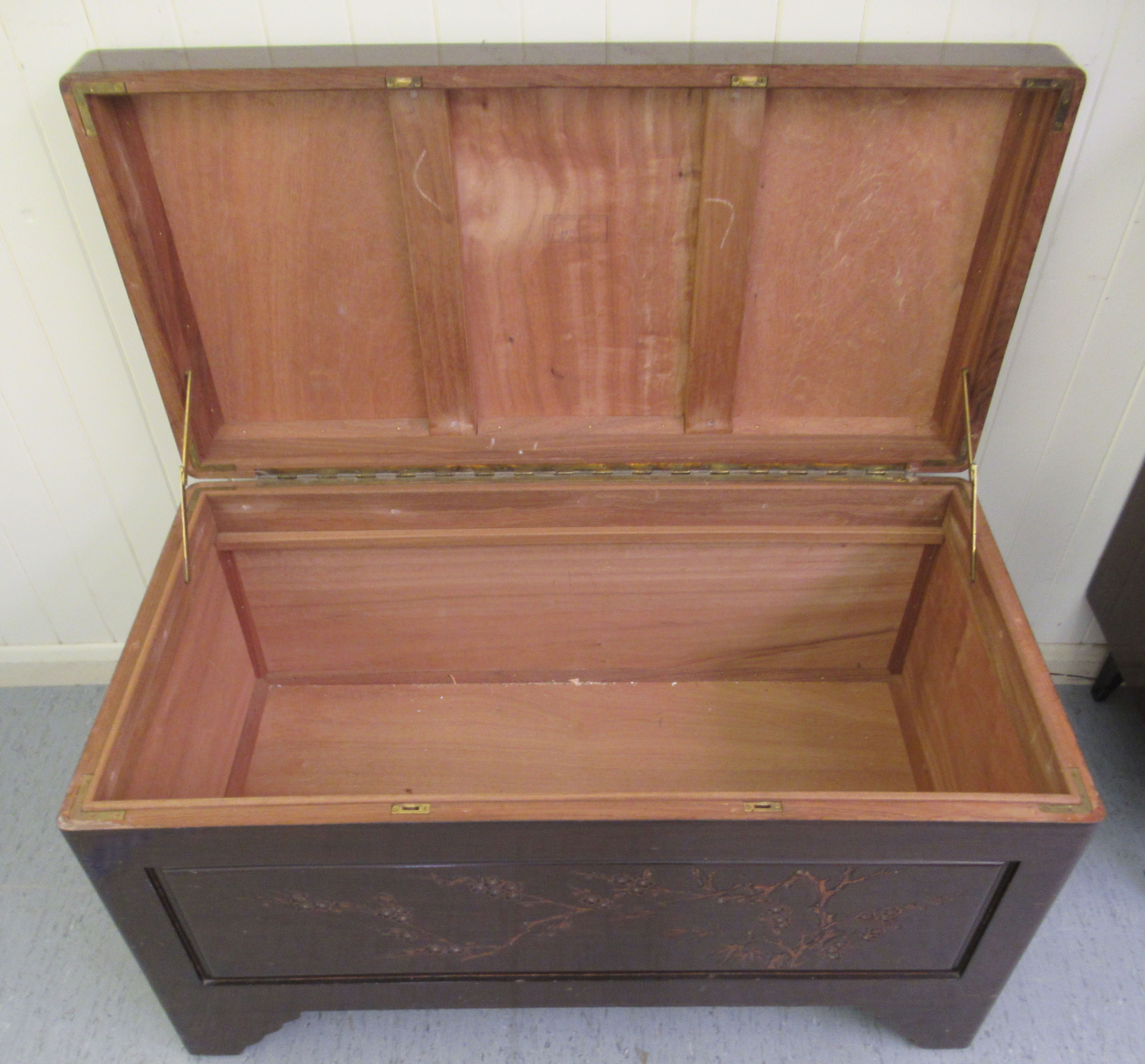 A mid 20thC Chinese carved camphorwood chest, having straight sides and a hinged lid, raised on - Image 4 of 6