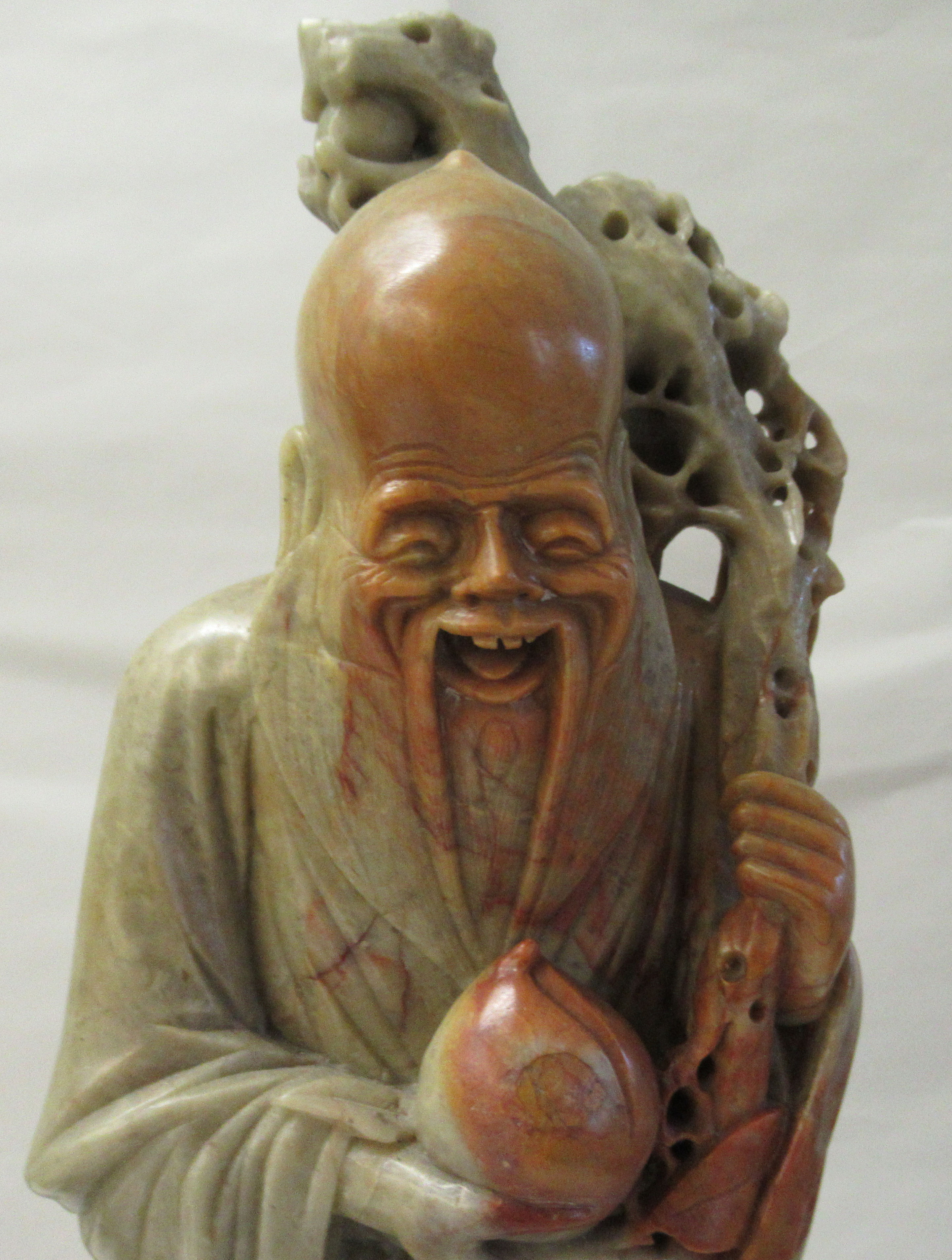 A matched pair of 20thC Chinese carved green and brown soapstone standing figures, each with a - Image 3 of 4