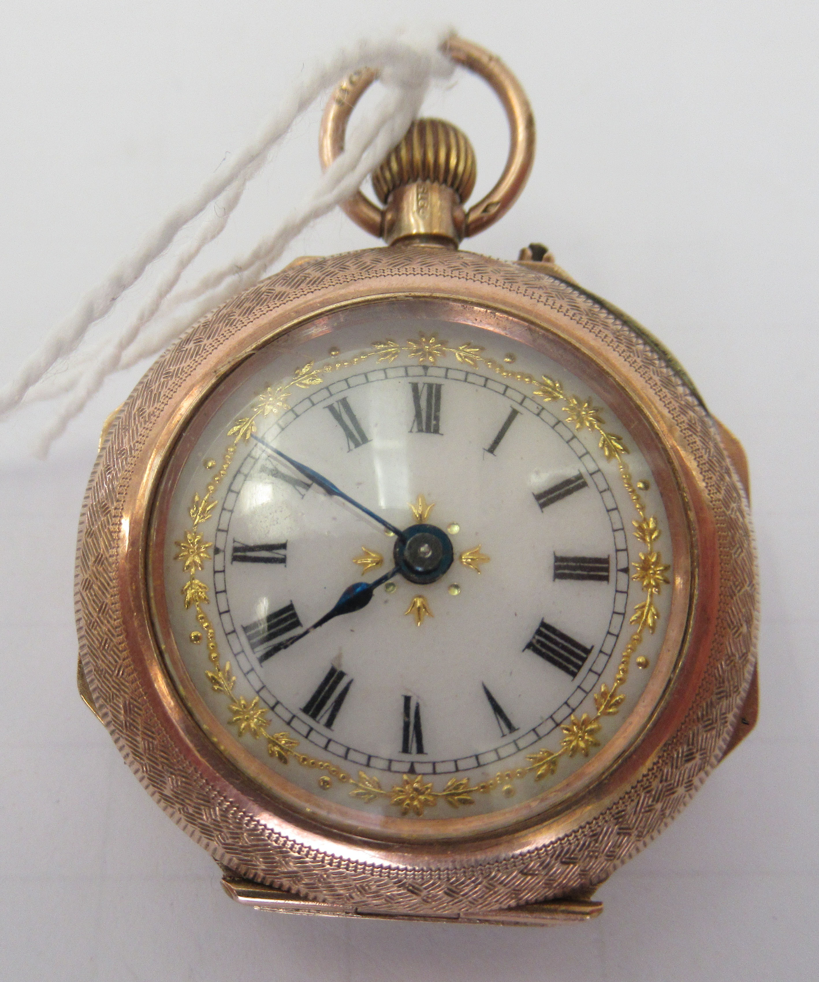 A 9ct gold cased fob watch with engraved and enamelled green ornament, the keyless movement faced by