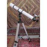 """A Meade telescope with a 6x30mm lens 41""""L, on a tripod stand 38""""h"""