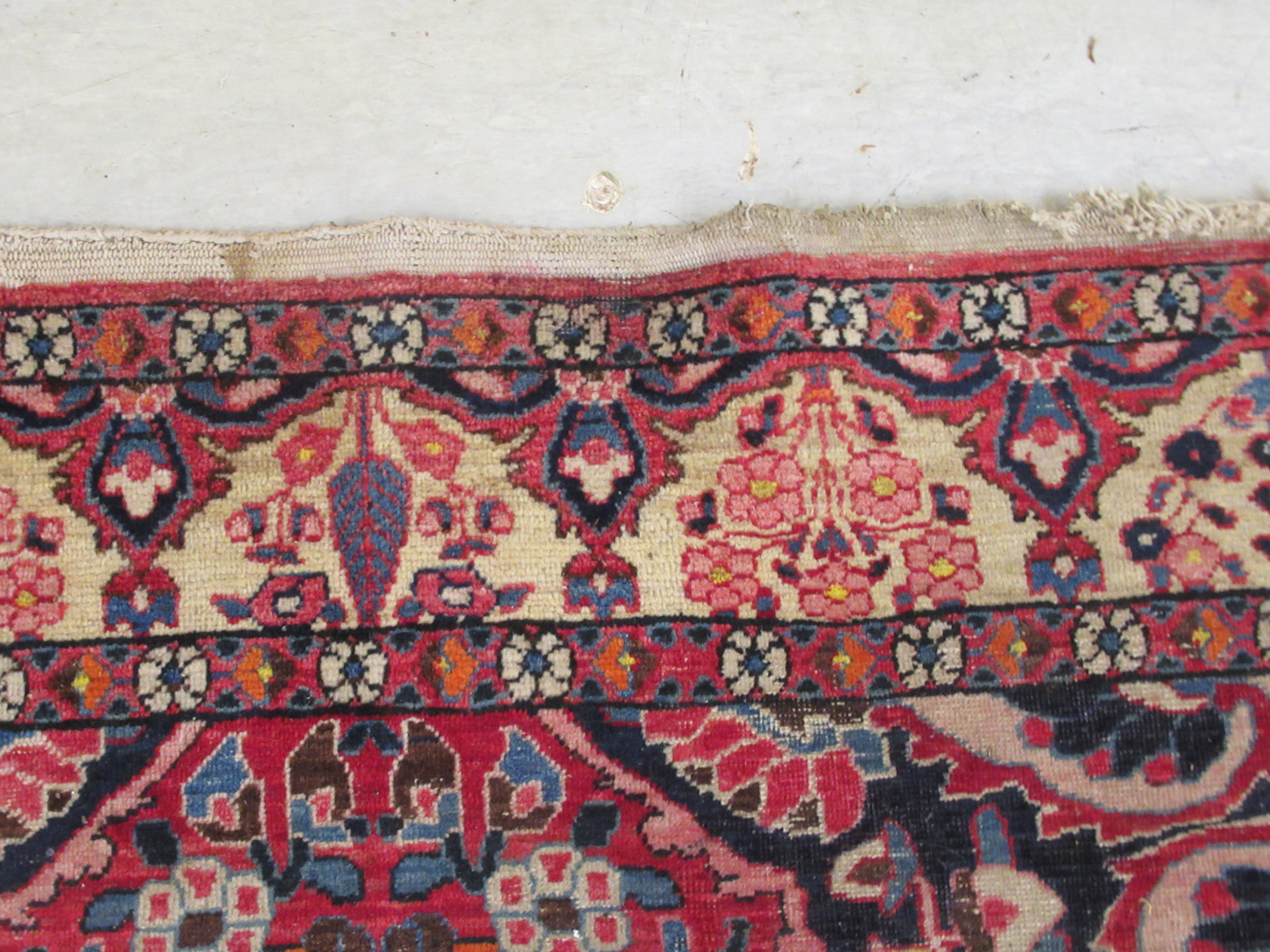 A Persian carpet, profusely decorated with flora and other designs, on a multi-coloured and red - Image 3 of 5