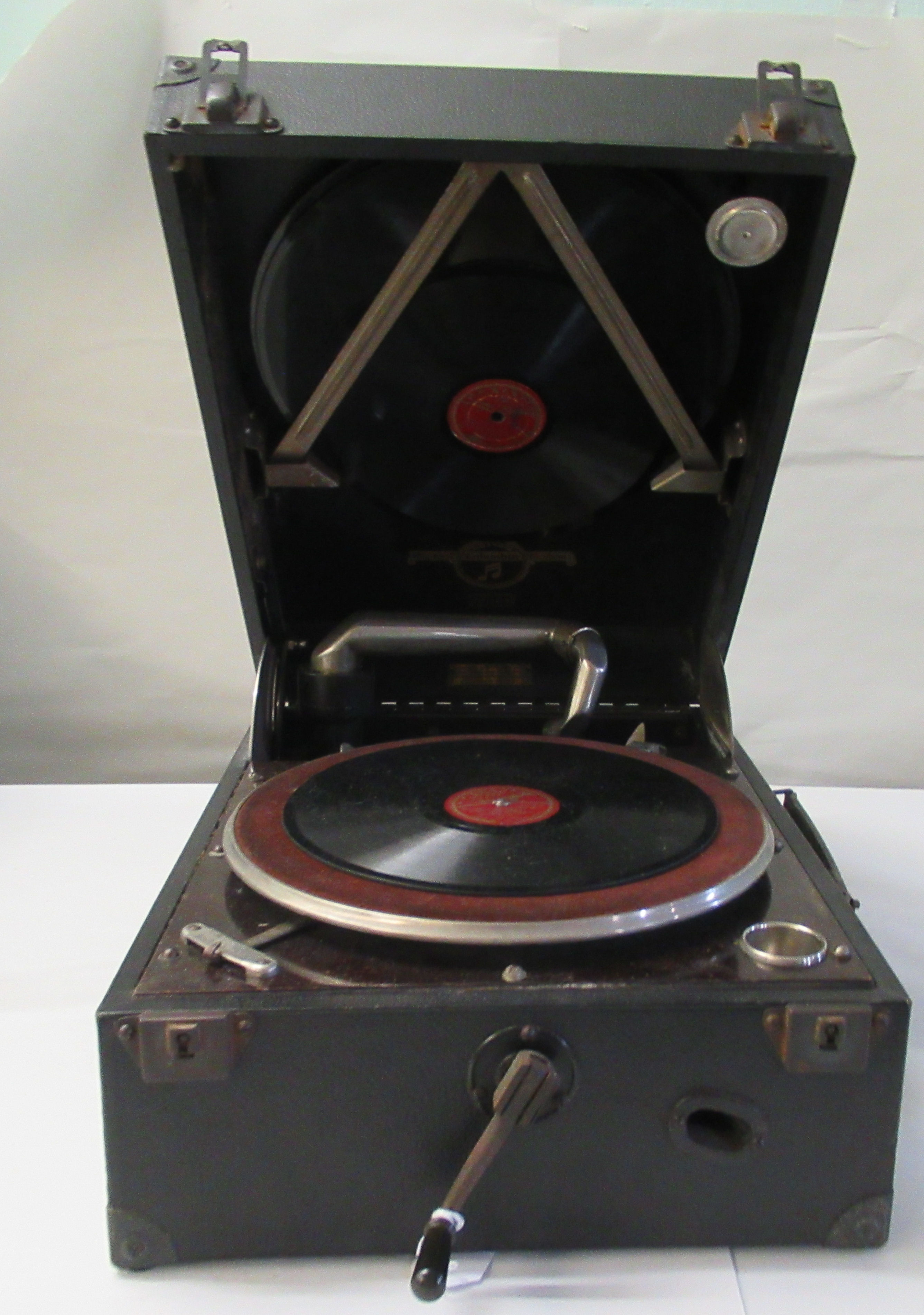 A 1930s Columbia portable gramophone with a folding handle, in a black fabric covered case