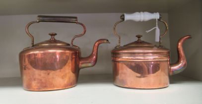 Two late Victorian copper kettles, each with a fixed top handle