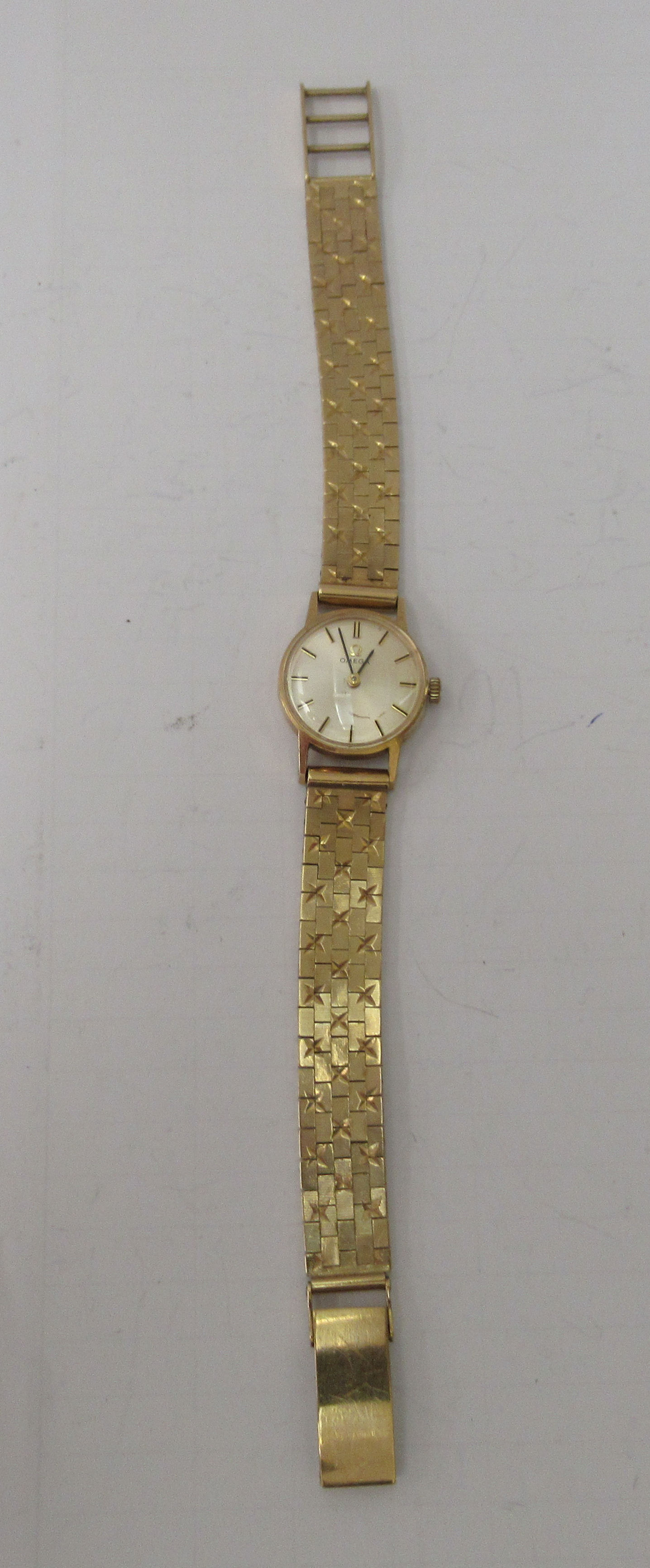 A lady's Omega 9ct gold cased wristwatch, faced by a baton dial, on a 9ct gold flexible strap - Image 2 of 3