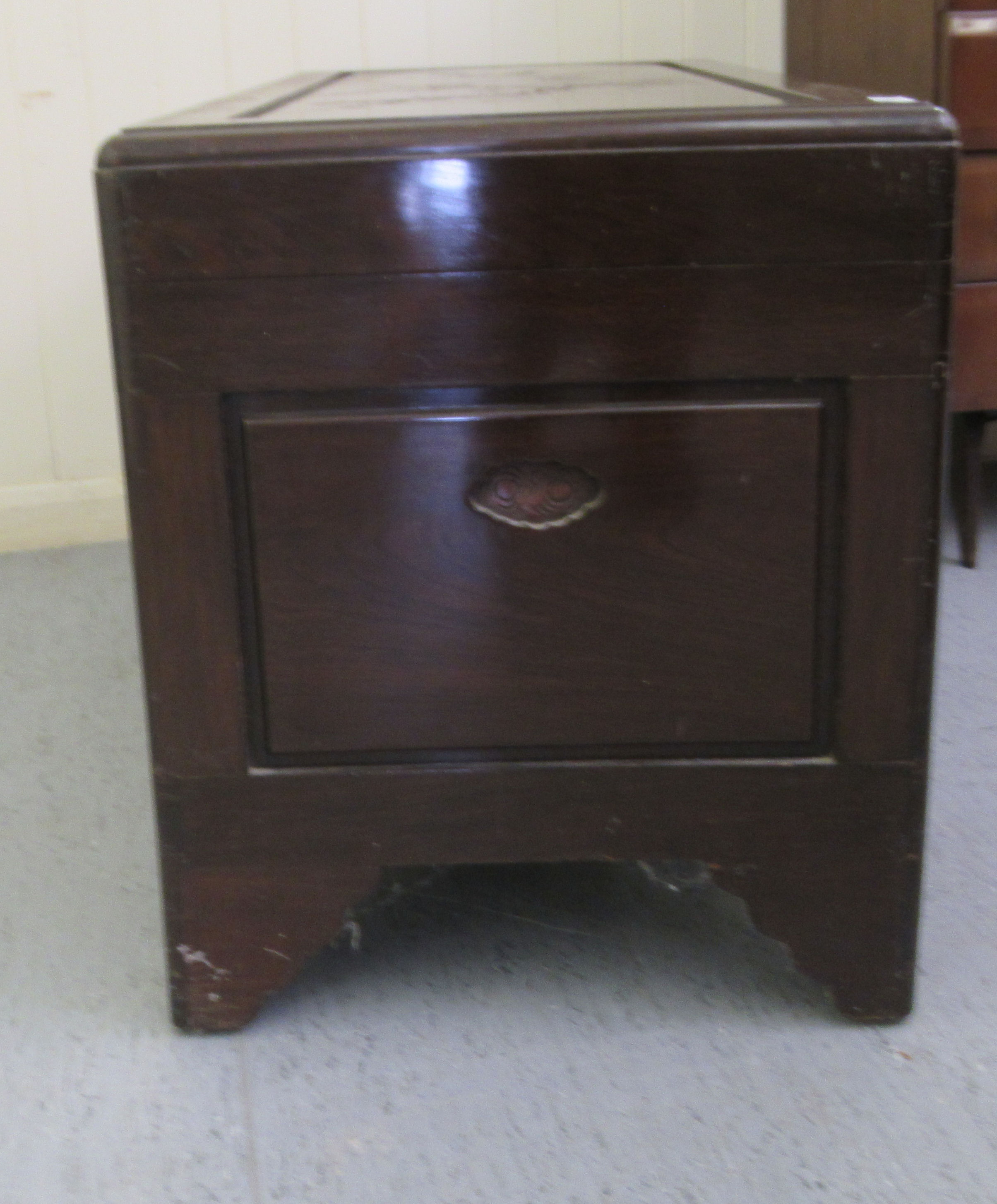 A mid 20thC Chinese carved camphorwood chest, having straight sides and a hinged lid, raised on - Image 6 of 6
