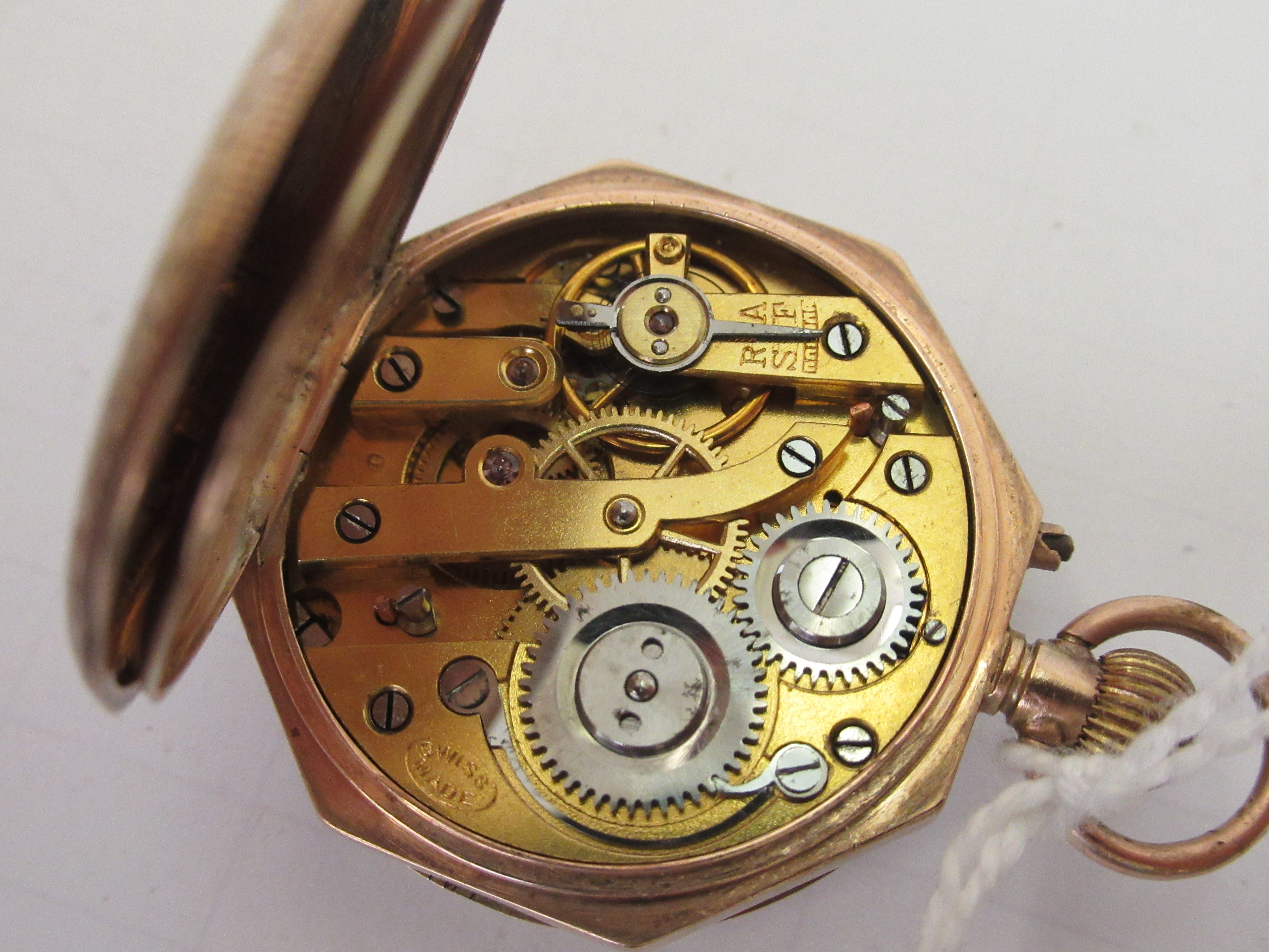 A 9ct gold cased fob watch with engraved and enamelled green ornament, the keyless movement faced by - Image 3 of 5