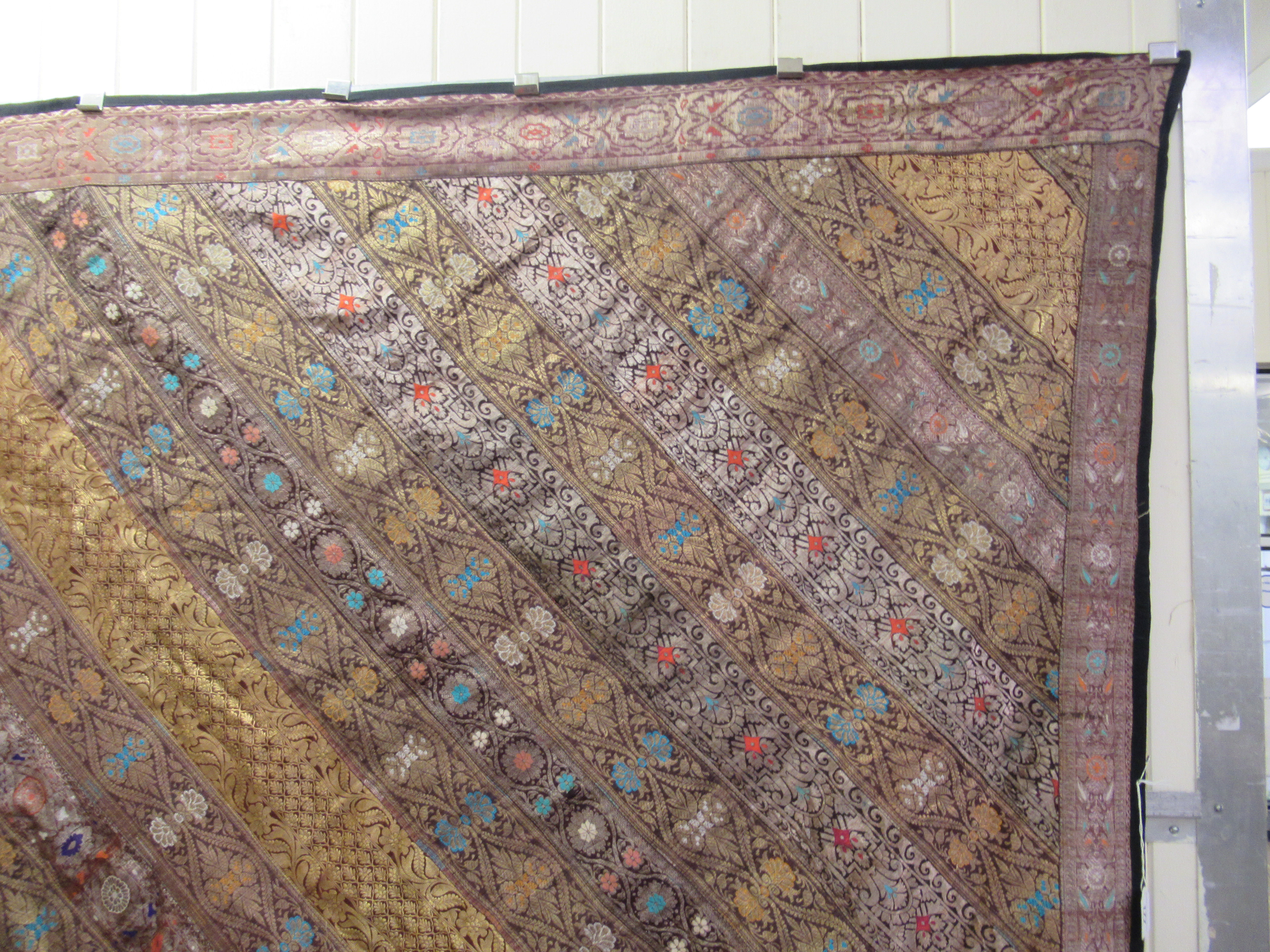An Indian part silk bed throw, profusely decorated with repeating floral designs with a black fabric - Image 3 of 7