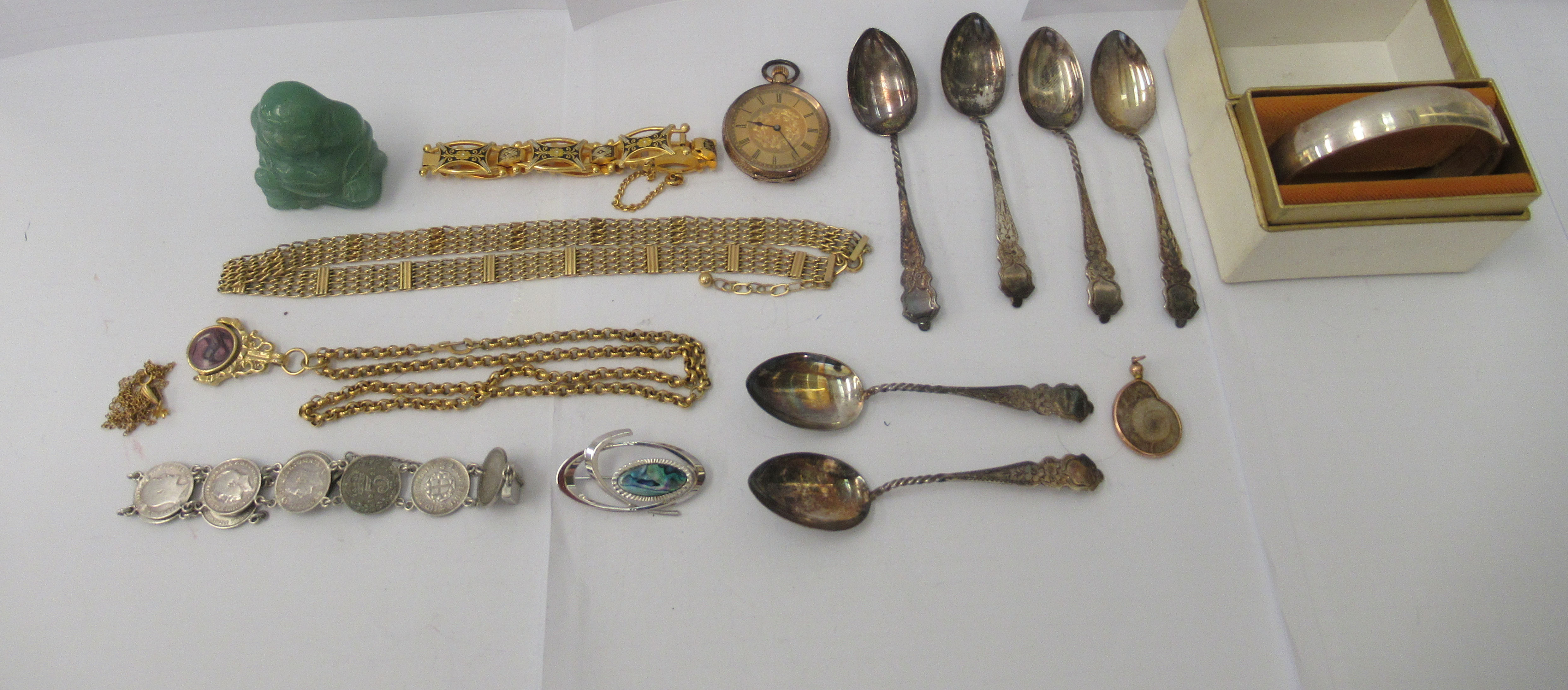 Personal ornament and collectables: to include a silver hinged bangle; and a yellow metal fob watch