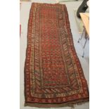 """A Kazak runner, decorated with repeating stylised designs, on a multi-coloured ground 45"""" x 114"""""""