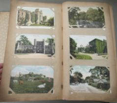 An uncollated postcard album, containing coloured and monochrome issues, church interiors and scenic
