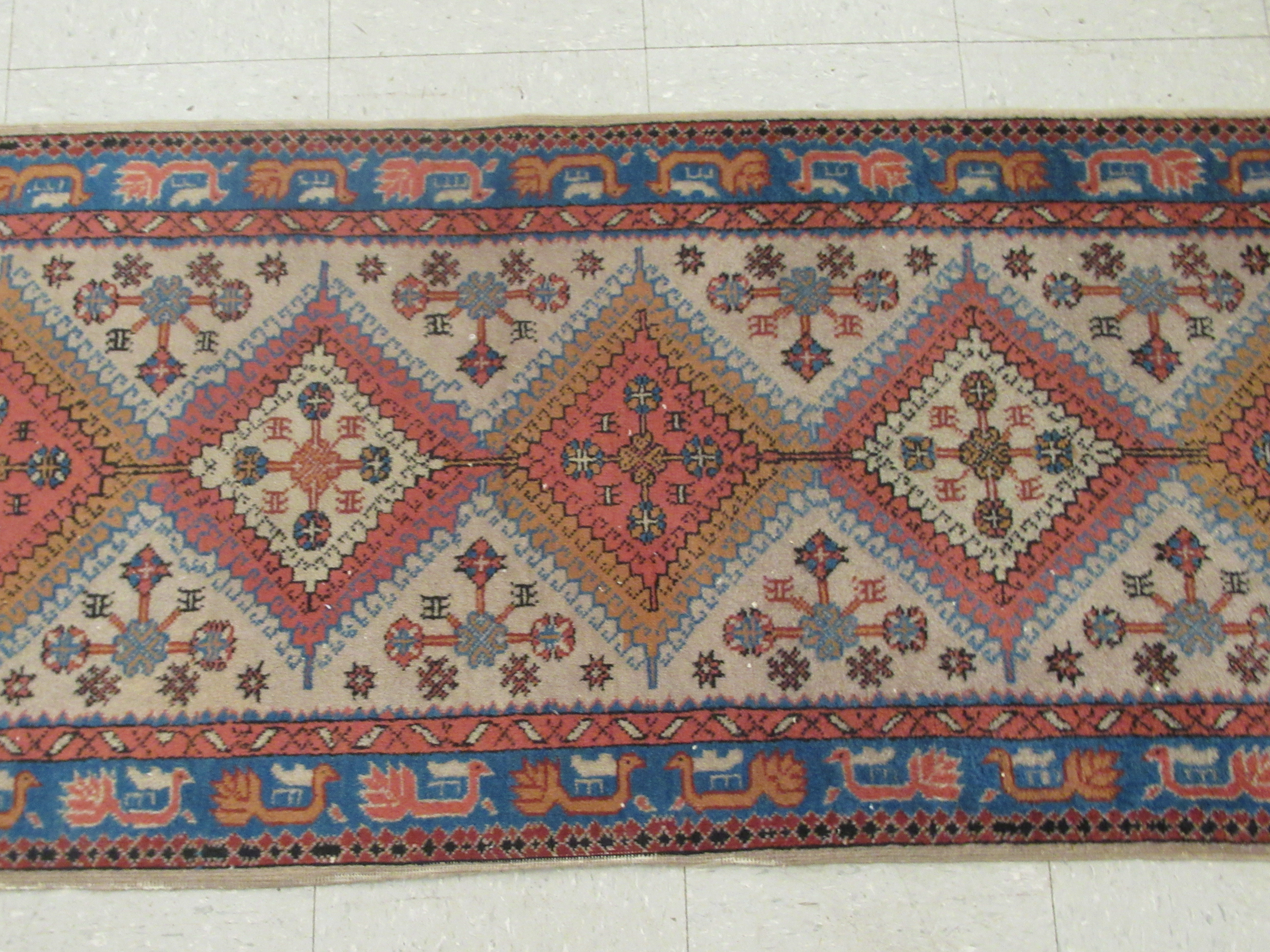 A Samarkand runner, decorated with repeating diamond formations, bordered by stylised designs, on - Image 2 of 5