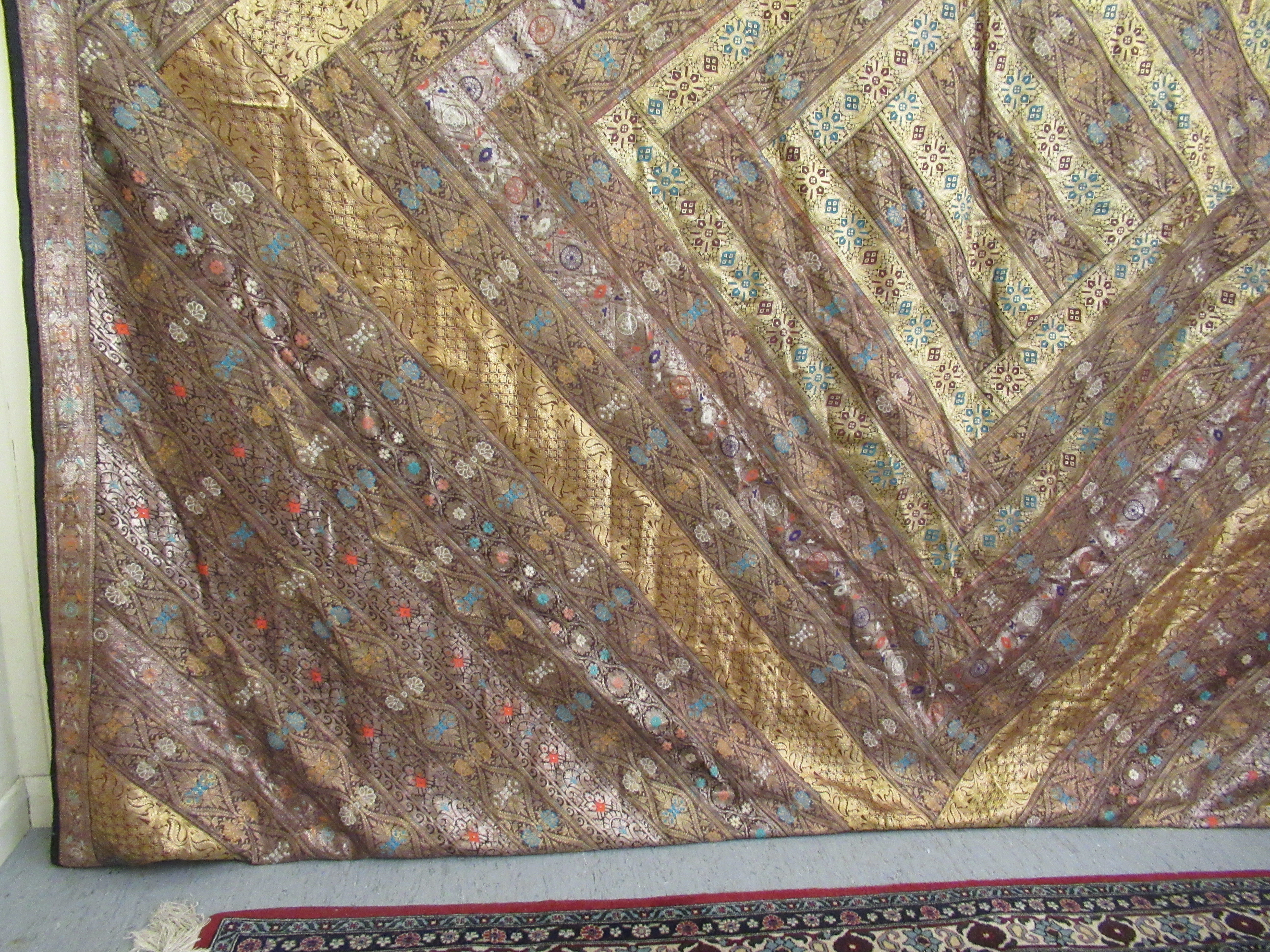 An Indian part silk bed throw, profusely decorated with repeating floral designs with a black fabric - Image 5 of 7