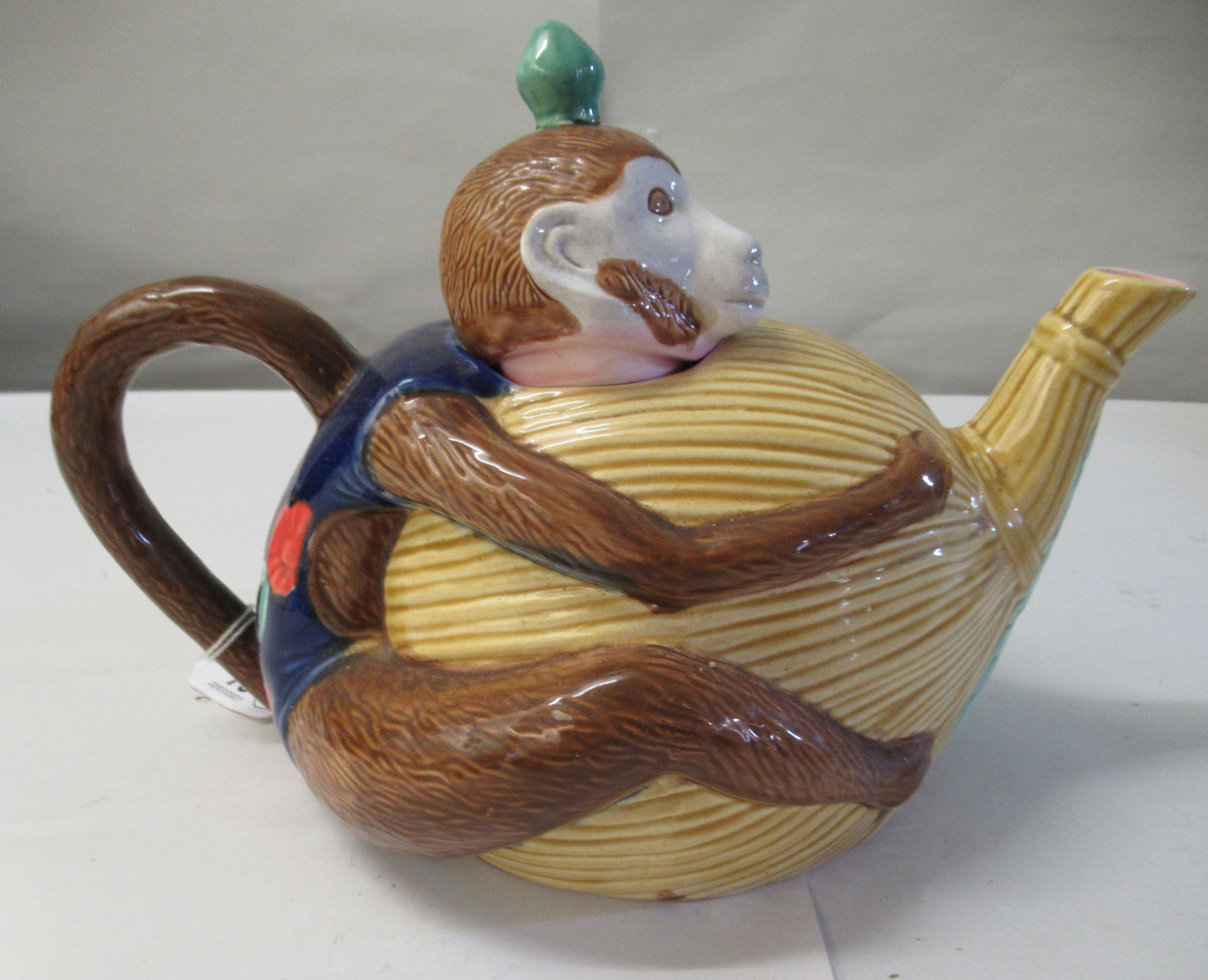 A 20thC reproduction of a Minton majolica teapot, fashioned as a monkey - Image 2 of 5