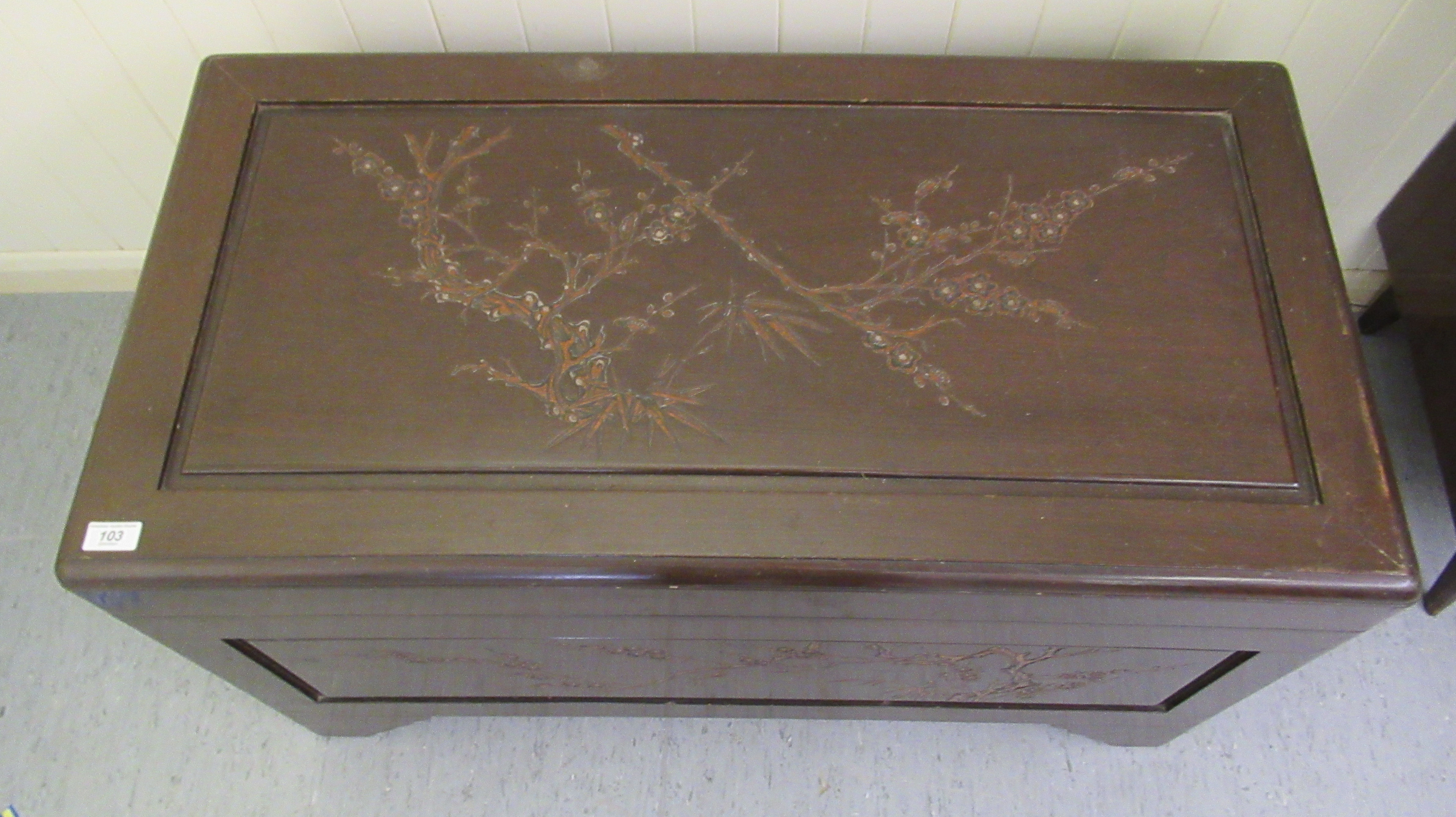 A mid 20thC Chinese carved camphorwood chest, having straight sides and a hinged lid, raised on - Image 5 of 6