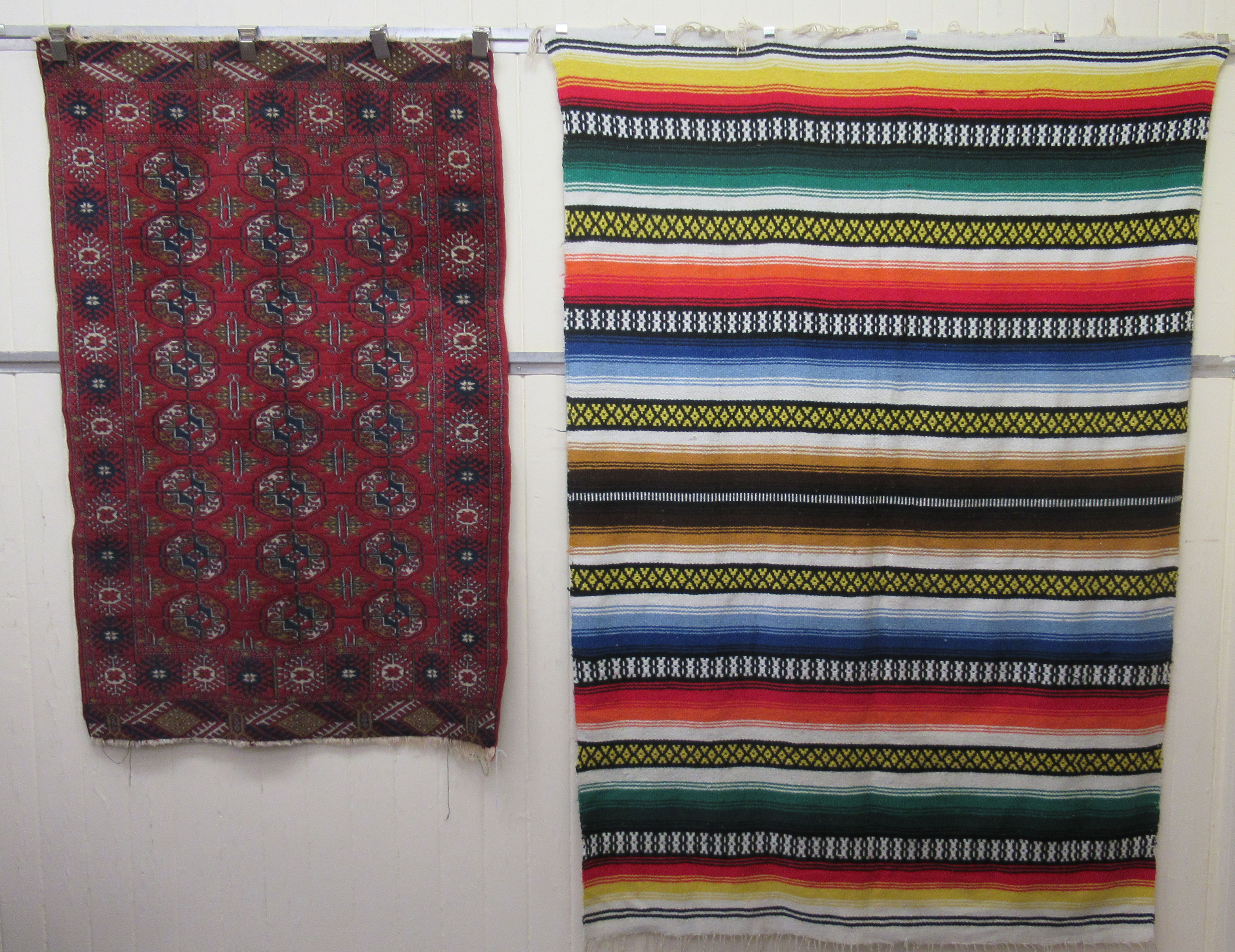 """A Bokhara rug, decorated with three columns of eight octagonal guls, on a red ground 39"""" x 63""""; and"""