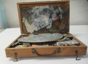 """An Edwardian mahogany artists box 3""""h 12""""w containing mainly used paints"""