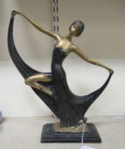 "A cast and part painted bronze figure, a 1920s dancer, on a plinth 15""h"