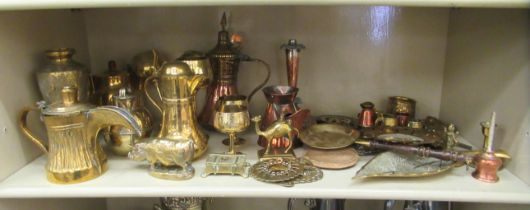 20thC decorative metalware: to include Middle Eastern style teapots and desktop paperweights