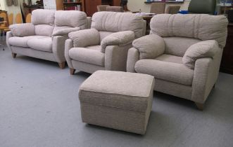 A modern textured grey patterned fabric upholstered three piece suite comprising a two seater