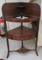 "A George III mahogany quadrant washstand, raised on splayed legs 40""h 22""w"