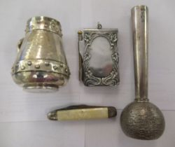 Silver collectables: to include a cream jug; a paperweight; a fruit knife; and a silver plated