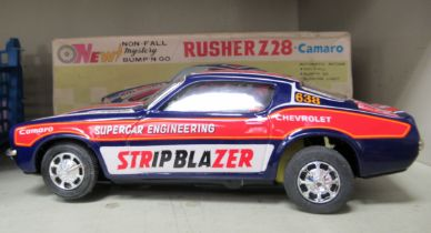 A 1969 Rusher Z28 Camaro Bump-n-Go tinplate, battery powered toy car boxed