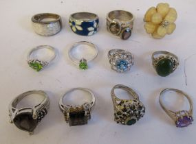 Silver and other white metal rings, each variously set with enamel and/or coloured stones