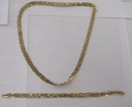 An Italian 9ct bi-coloured gold, crossover design bracelet; and matching necklace