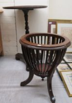 A William IV mahogany pedestal table, on a tapered, reeded column and an incurved triform