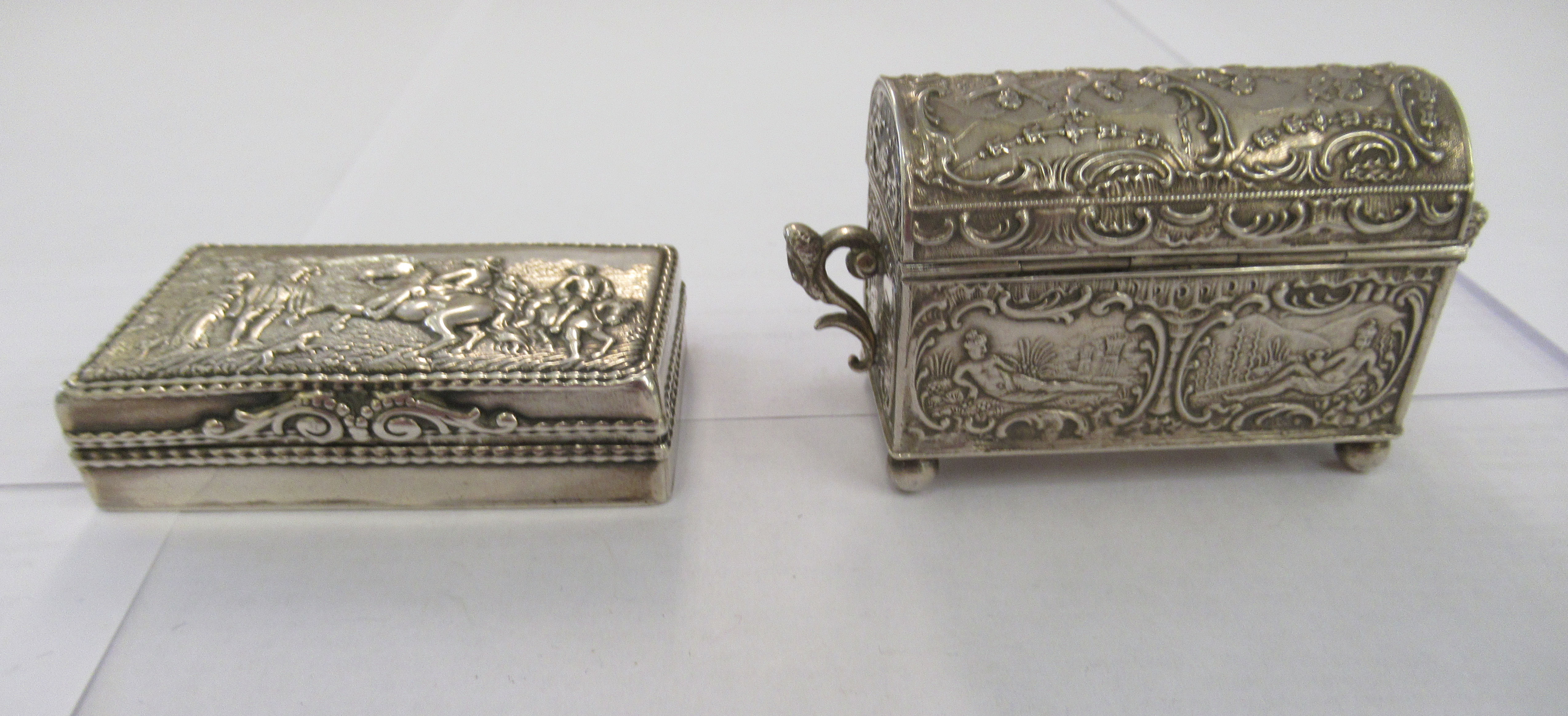 Two early 20thC Continental silver coloured metal items, viz. a domed twin handled, casket deign