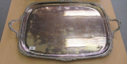 A Victorian style Goldsmiths & Silversmiths silver plated twin handled serving tray with a ribbed,
