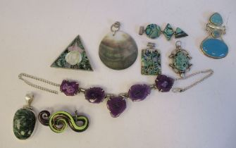 Silver and white metal costume jewellery, mainly pendants, set with mother-of-pearl, paua shell